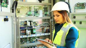 Maintenance worker analyzing machines